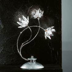 Exclusive Tischleuchte mit klaren Kristallblüten und Blattfolienversilberung